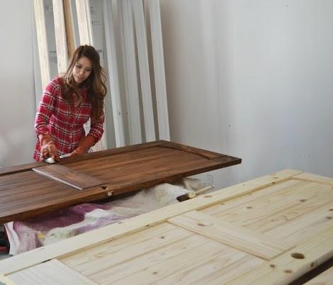 Finsihing external wooden doors in secure, flat position
